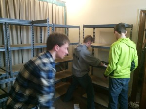Youth constructing shelves for our Gospel Outreach Food Pantry in Newark, NJ